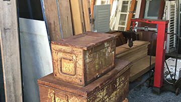 tin cases in burleigh secondhands yard
